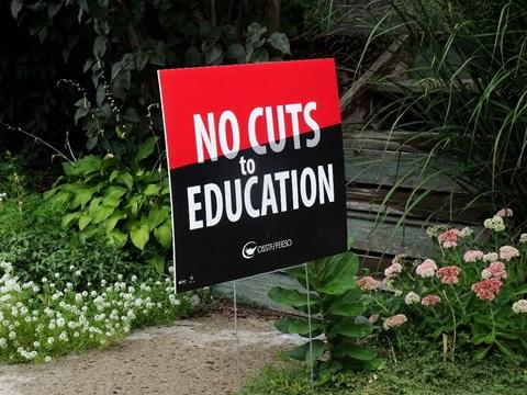 Custom yard sign of No cuts in Detroit